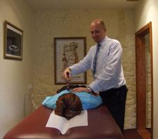Dr Ed Bates adjusting a patient.