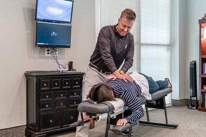 Dr. Matt adjusting womans back
