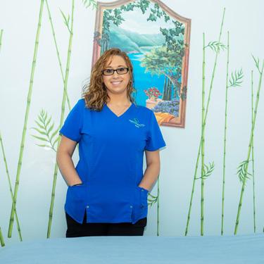 Massage Therapist in the massage room