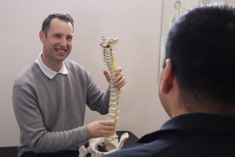 Dr. Rhodes showing spine model