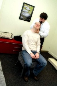 Dr. Myer adjusting a patient.