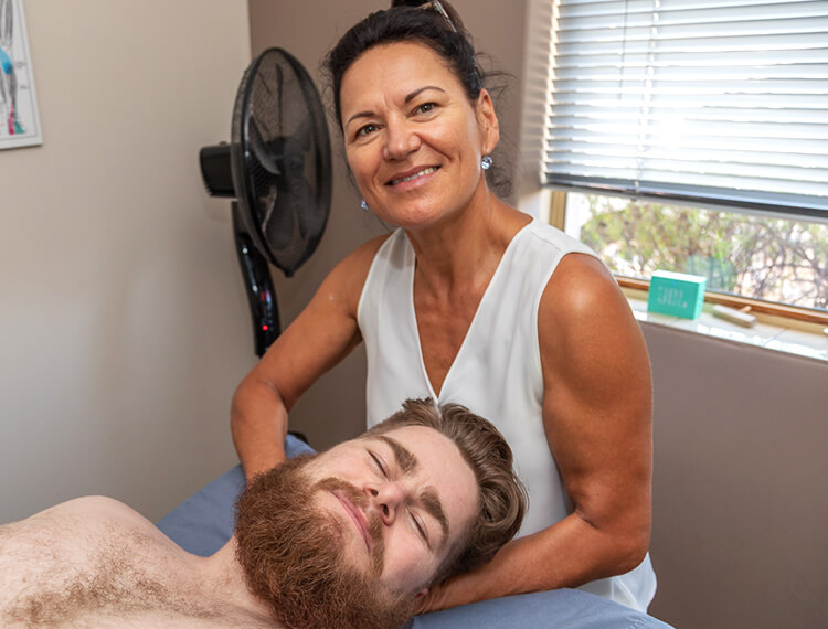 Kathleen Williams, Registered Massage Therapist with a client