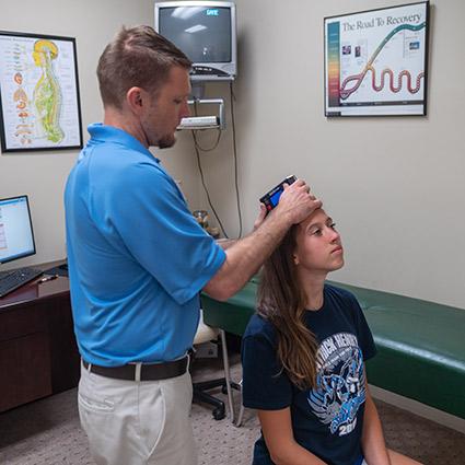 Dr. Brian adjusting teen