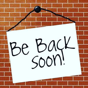 Be Back Soon sign on brick wall