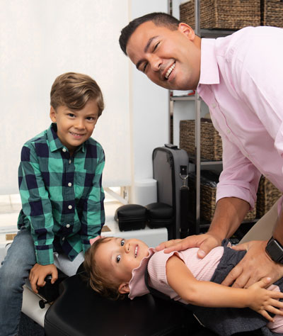 Dr. Gioffre Adjusting His Children