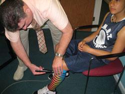 Dr. Kunkel adjusting young boy