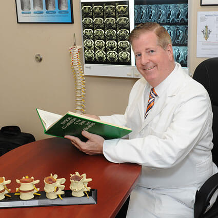 Dr. Adolph at his desk
