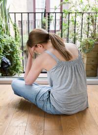 Woman sad sitting on the floor