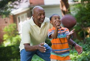 senior man playing with grandson