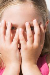 Girl shielding her face