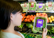 Woman reading a food label in supermarket