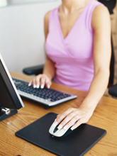 A woman sitting at her desk on the computer