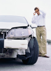Man on phone after auto accident