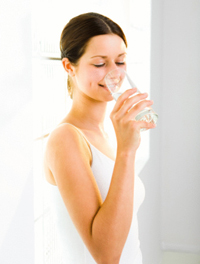 Woman drinking from glass of water