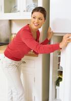Woman opening refridgerator