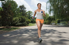 Woman running in street