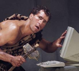 a caveman at a computer