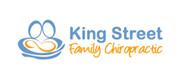 stylized couple holding infant chiropractic logo sample