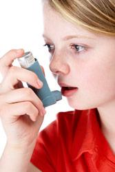 Child with asthma inhaler image