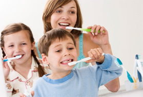 Family brushing their teeth together