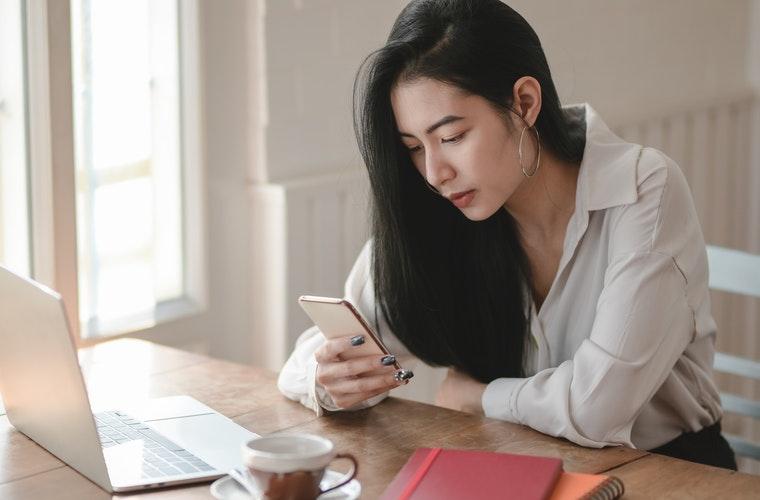 woman-on-phone-laptop