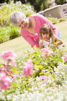 Grandma gardening with her grandaughter