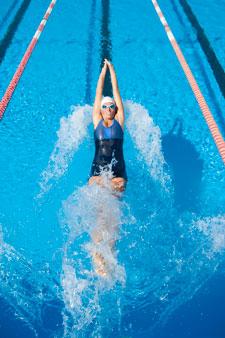 Woman swimming laps.