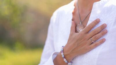 Woman hand on heart
