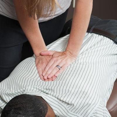 Doctor adjusting mans back