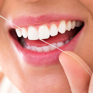 Close-up of woman flossing