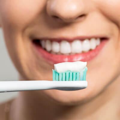 Woman ready to brush teeth