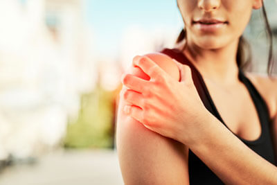 Woman with intense shoulder pain