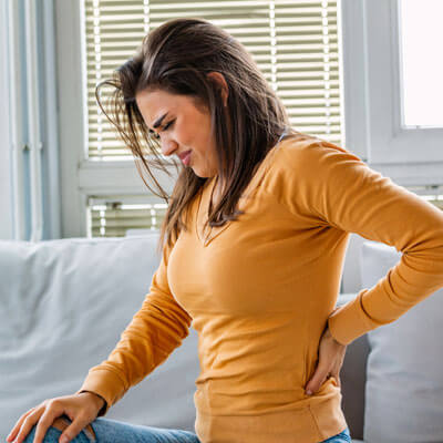 Woman with sore back