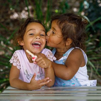Sisters laughing at picnic table
