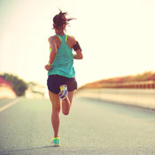 Woman running down road